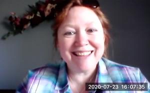 A screenshot of a video call showing Jenn smiling