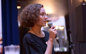 A photo of someone giving a talk or speech at a GenNext event.